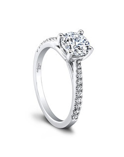 (0.16 ttl) It's love. Tilly's delicate details make your diamond even more bold. A single row of pave diamonds tapers toward the center to show off your center stone. A classic silhouette with a romantic soul. Can be custom made to fit any shape center stone. Hand crafted in either Platinum, 18K Gold or 14K Gold.(Price Details:Price excludes center stone)