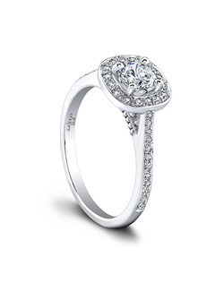 (0.21 ttl) A stunning sparkler. The Twyla Engagement Ring's fabulous pavé set diamonds enliven a slender, feminine band, while an exuberant diamond halo casts a brilliant, shimmering light. The Twyla Engagement Ring's beaded gallery makes the design even more unique. Can be custom made to fit any shape center stone. Hand crafted in either Platinum, 18K Gold or 14K Gold.