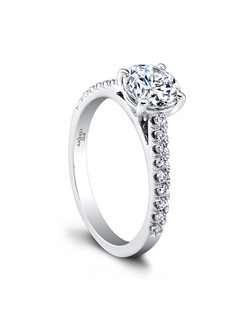 (0.26 ttl) Clean, classic and lovely. The Theodora Engagement Ring's single straight row of pavé-set round diamonds enlivens a decidedly sleek silhouette. Can be custom made to fit any shape center stone. Hand crafted in either Platinum, 18K Gold or 14K Gold.(Price Details:Price excludes center stone)