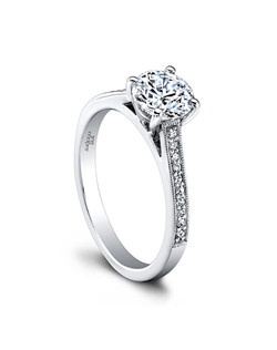 (0.09 ttl) Feminine, graceful Henriette. The Henriette Round Engagement Ring's bead-set diamonds lead to a glorious round center stone. Millgrain channel walls lend a romantic, heirloom quality. Can be custom made to fit any shape center stone. Hand crafted in either Platinum, 18K Gold or 14K Gold.(Price Details:Price excludes center stone)