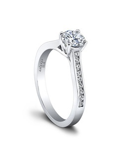 (0.18ttl) A classic four prong setting with a twist. The Elyse Engagement Ring enhances your center diamond with a constellation of round diamonds, contained within a sleek channel setting. Elyse's articulated prongs embrace your center diamond with the added dimension of a subtle crossover detail. Can be custom made to fit any shape center stone. Hand crafted in either Platinum, 18K Gold or 14K Gold.(Price Details:Price excludes center stone)