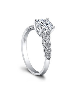 (0.13 ttl) A classic profile with an engaging twist. A tapering leaf motif and millgrain details bring high romance to our Lola Engagement Ring. Your center stone is accentuated by Lola's interesting, artful lines. Can be custom made to fit any shape center stone. Hand crafted in either Platinum, 18K Gold or 14K Gold.