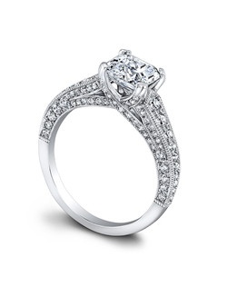 (0.7 ttl) Hazelle's incredible details surround your center stone in sparkle. Artfully entwined prongs arise from a pavé diamond encrusted galley, that joins gracefully with shoulders encrusted in more diamonds. Millgrain edges lend an heirloom feel, while defining the beautiful contours of Hazelle's band. Can be custom made to fit any shape center stone. Hand crafted in either Platinum, 18K Gold or 14K Gold.(Price Details:Price excludes center stone)
