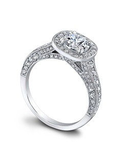 (0.78 ttl) Truly, madly, deeply. The Honor Engagement Ring has all the detail and sparkle to match the intensity of your love. Intricate pavé set diamonds twinkle against the backdrop of a highly polished band and sweet millgrain edges. A modern rounded square shape reinvents a halo of even more diamonds, which surrounds your center stone with passion and fire. Can be custom made to fit any shape center stone. Hand crafted in either Platinum, 18K Gold or 14K Gold.(Price Details:Price excludes center stone)
