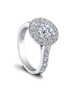 (0.86 ttl) A symbol of love and a stunning fashion statement. The Harlow Engagement Ring's pavé set diamonds create a dazzling display of glamour for those who dare to be bold and brilliant. The sparkling, intricate patterns they form are an unending source of wonder and delight for the eye. Can be custom made to fit any shape center stone. Hand crafted in either Platinum, 18K Gold or 14K Gold.