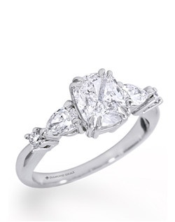 Shown in 18K white gold with 1.5ct cushion cut center, 0.3ctw Pear Shape side stones and0.08ctw round side stones(Price excludes center stone)