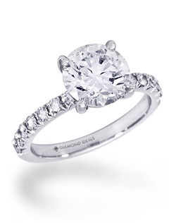 Shown in 14K white gold with 2ct round center, 0.35ctw of small diamonds on shank.(Price excludes center stone)