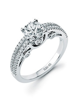 This stunning semi-mount is shown with a 1ct center diamond. Available in 18K white or yellow gold and platinum. Prong set for durability with diamonds calibrated to 1/100th of a millimeter. Settings can be custom made to fit any size or shape center stone. Total weight of semi-mount 0.36 Ct. Matching band available - Style number DR-621A(Price excludes center stone)