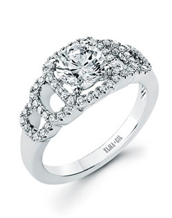 This stunning semi-mount is shown with a 1ct center diamond. Available in 18K white or yellow gold and platinum. Prong set for durability with diamonds calibrated to 1/100th of a millimeter. Settings can be custom made to fit any size or shape center stone. Total weight of semi-mount 0.30 Ct. Matching band available - Style number DR-629A(Price excludes center stone)