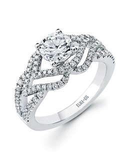 This stunning semi-mount is shown with a 1ct center diamond. Available in 18K white or yellow gold and platinum. Prong set for durability with diamonds calibrated to 1/100th of a millimeter. Settings can be custom made to fit any size or shape center stone. Total weight of semi-mount 0.59 Ct. Matching band available - Style number DR-636A(Price excludes center stone)