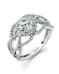 This stunning semi-mount is shown with a 1ct center diamond. Available in 18K white or yellow gold and platinum. Prong set for durability with diamonds calibrated to 1/100th of a millimeter. Settings can be custom made to fit any size or shape center stone. Total weight of semi-mount 0.55 Ct. Matching band available - Style number DR-666A(Price excludes center stone)