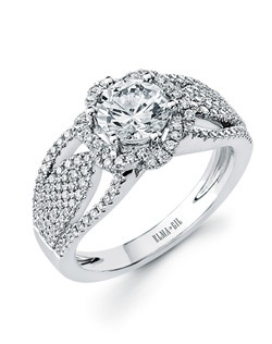 This stunning semi-mount is shown with a 1ct center diamond. Available in 18K white or yellow gold and platinum. Prong set for durability with diamonds calibrated to 1/100th of a millimeter. Settings can be custom made to fit any size or shape center stone. Total weight of semi-mount 0.50 Ct. Matching band available - Style number DR-669A(Price excludes center stone)