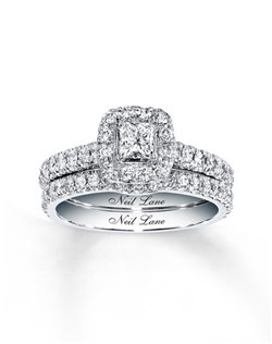 A princess-cut diamond takes center stage in her dramatic engagement ring as part of this bridal set from the Neil Lane Bridal® collection. A supporting cast of round diamonds frames the center and lines the band of the engagement ring and matching wedding band. The wedding band is contoured to fit alongside the engagement ring for a design worthy of applause. Neil Lane's signature appears on the inside of the bands. The bridal set is crafted of 14K white gold and has a total diamond weight of 1 carat.