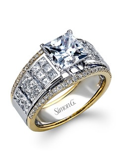 18K white and yellow gold ring comprised of 0.30ctw round white diamonds and 1.28ctw princess diamonds.