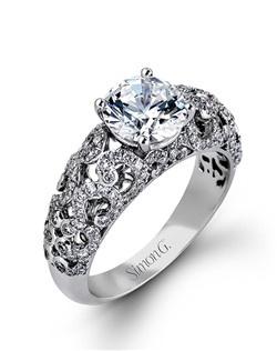 18K white gold ring comprised of 0.65ctw round white diamonds.