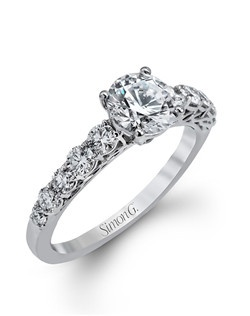 18K white gold ring comprised of 0.57ctw round white diamonds.