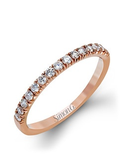 18K rose gold band comprised of 0.30ctw round white diamonds.