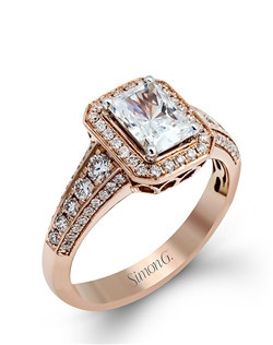18K rose gold ring comprised of 0.57ctw round white diamonds.