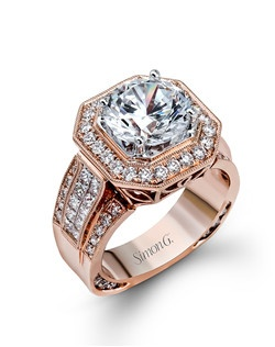 18K rose gold ring comprised of 0.87ctw round white diamonds and 0.70ctw princess diamonds.
