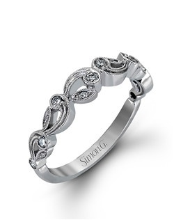 18K white gold ring comprised of 0.15ctw round white diamonds.