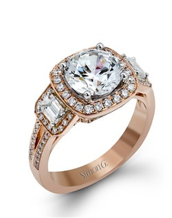 18K rose gold ring comprised of 0.44ctw round white diamonds and 0.45ctw emerald cut diamonds.