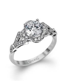 18K white gold ring comprised of 0.21ctw round white diamonds.