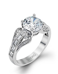 18K white gold ring comprised of 0.11ctw round white diamonds and 0.56ctw baguette diamonds.