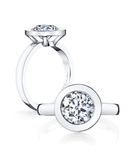Handcrafted, custom made Jean Dousset signature design.  Shown with a Round Brilliant Cut and Emerald Cut Diamond center stone.  Available in platinum or 18k gold - Pictured in Platinum.  Includes your choice of damond or gem Signature Stone, exclusively by Jean Dousset.