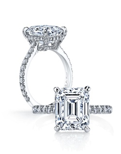 Handcrafted, custom made Jean Dousset signature design.  Available in all diamond cuts - Shown with Round Brilliant, Emerald and Cushion Cut diamond center stones.  Available in platinum or 18k gold - Pictured in Platinum.  Includes your choice of damond or gem Signature Stone, exclusively by Jean Dousset.