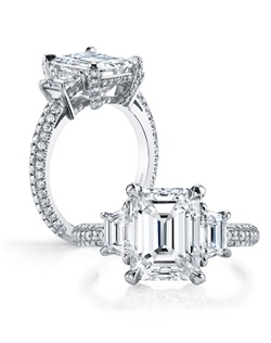 Handcrafted, custom made Jean Dousset signature design.  Available in all diamond cuts - Shown with an Emerald Cut diamond center stone.  Available in platinum or 18k gold - Pictured in Platinum.  Includes your choice of damond or gem Signature Stone, exclusively by Jean Dousset.