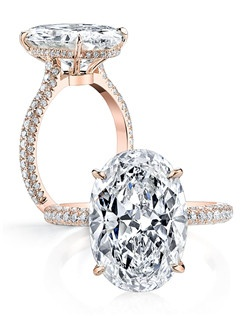 Handcrafted, custom made Jean Dousset signature design.  Available in all diamond cuts - Shown with an Oval Cut Cut diamond center stone.  Available in platinum or 18k gold - Pictured in 18k Rose Gold.  Includes your choice of damond or gem Signature Stone, exclusively by Jean Dousset.