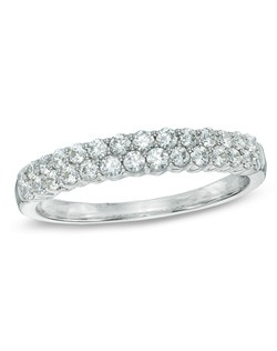 Honor her on that special anniversary with this exquisite diamond anniversary band. Expertly crafted in 14K white gold, this eye-catching comfort-fit design showcases two rows of shimmering diamonds set one atop the other. Simple and so elegant, this ring can be worn alone or with her diamond solitaire or engagement ring. Designed to sparkle for a lifetime, this ring captivates with 1/2 ct. t.w. of diamonds and a bright polished shine.