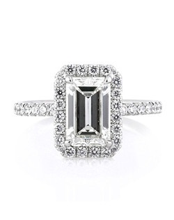 This magnificently beautiful emerald cut diamond engagement ring is jaw dropping! The phenomenal 1.80ct emerald cut center diamond is GIA certified at I-IF. It is white and flawless in clarity! The cut is exceptionally beautiful as well. It looks as large as most two carat plus emerald cut center stones. The custom made platinum setting features a halo of round diamonds and a row of round diamonds set down the sides. The center basket is also studded with round diamonds. The diamonds are all set in a beautiful micropave setting. Clean lines, elegant and classic. An amazing emerald cut engagement ring you will cherish!