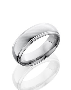 This Cobalt Chrome men's wedding band is 7mm wide with a custom dome design and angled grooved edges. The ring is polished to a glossy satin finish that creates the right touch of classic and modern design.