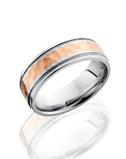 This Cobalt Chrome men's wedding band is 7.5mm wide using a custom flat design with grooved milgrain edges and a 3mm 14K Rose Gold inlay. The rose gold inlay of this ring is carefully hammered to create brilliant light-capturing texture to this classic design.