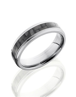 This sophisticated Titanium men's wedding band is 6mm wide with a custom flat design and has carefully carved edges with a 3mm Carbon Fiber inlay.