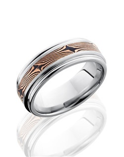This Cobalt Chrome men's wedding band is 8mm wide with a rounded edge flat design with a one 3mm inlay of 14K Rose Gold bonded with Shakudo. Shakudo is a Japanese precious metal and when bonded with Gold it creates the Mokume Gane swirled pattern.