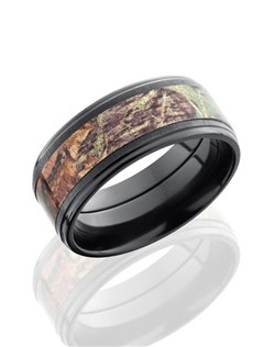 This masculine Black Zirconium men's wedding band is 9mm wide with a flat grooved edge. This ring contains one 5mm Mossy Oak Camo pattern inlay and is cross polished for a lustrous black satin finish. Bring out the best in him with this nature inspired design.