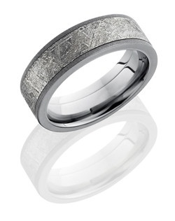 This unique Titanium men's wedding band is 7mm wide with a custom flat comfort fit design. This ring contains one 5mm Meteorite inlay and is sandblasted for a textured shimmer finish.