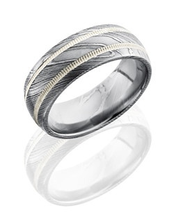 This stunning Damascus steel men's wedding band is 8mm wide with a custom dome design. This ring contains two 1mm Sterling Silver milgrain grooves and is polished to a lustrous satin finish.