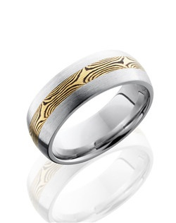 This modern Cobalt Chrome men's wedding band is 8mm wide with a custom dome design. This ring contains one 3mm of 18K Yellow Gold bonded with Shakudo inlay and is polished to a satin finish for a lustrous shine. Shakudo is a Japanese precious metal and when bonded to Gold it creates our Mokume Gane swirled pattern.