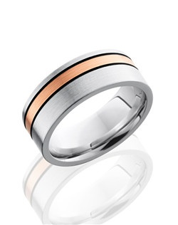This sophisticated Cobalt Chrome men's wedding band is 8mm wide with a custom flat comfort fit design. This ring contains one 2mm off center 14K Rose Gold inlay with mil-grooved black antiqued edges and is polished to a satin finish.