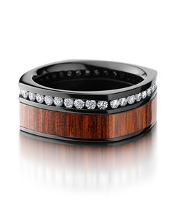 This striking Black Zirconium men's wedding band is 9.5mm wide with a custom flat square design. This ring contains hardwood inlay and eternity set .03 Diamonds. Bring out the best in him with this extraordinary ring.