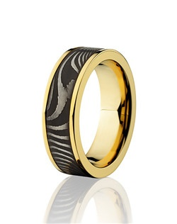 This masculine 18K Yellow Gold men's wedding band is 7mm wide with a custom flat twist design of Damascus steel. This ring is given an acid wash to create darker shimmer and the gold is polished for a lustrous shine.