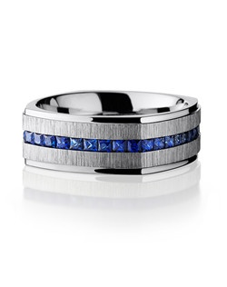 This striking Cobalt Chrome men's wedding band is 8mm wide with a custom flat square design. This ring contains eternity set pure sapphires and is cross polished to create ribbed texture and given a lustrous shine.