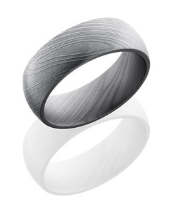 This stunning Damascus steel men's wedding band is 8mm wide with a custom dome design and is given a beadblast for a soft textured finish. This ring is the perfect touch of classic and modern design.