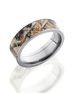 This unique Titanium wedding band is 7mm wide with a custom flat design. This ring contains a 6mm tree branch Camo pattern inlay. Bring out the best in him with this nature-inspired ring.