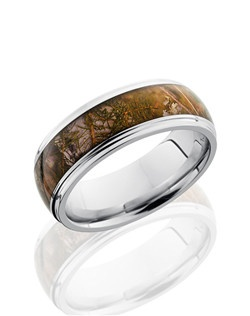 This sophisticated Cobalt Chrome men's wedding band is 8mm wide with a custom dome design and grooved edges. This ring contains a 5mm Kings Mountain Camo pattern inlay. Bring out the best in him with this nature-inspired design.