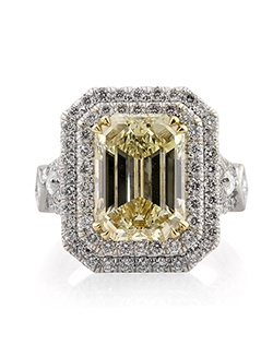 This extremely rare, magnificent and mesmerizing fancy yellow emerald cut diamond ring really shows you just how awesome mother nature is! The gorgeous 5.02ct emerald cut diamond poised in the center of this magnificent piece is GIA certified (one of the leaders in diamond grading) at Fancy Brownish Yellow - VS2. It has a very rich and vibrant fancy yellow color with no traces of brown whatsoever! The color is so exceptional we are surprised it wasn't graded at intense! It is set in a custom-made setting featuring a double halo of round diamonds set in a micropave setting. The split shank is set with two rows of diamonds as well with a gorgeous marquise cut diamond in the center. There is also a princess cut diamond bezel set at the bottom. This is truly a work of art! Magnificent in every way! This piece is surely going to become a family heirloom!