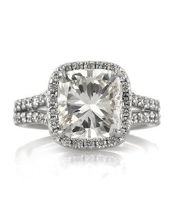 This exceptionally bright and beautiful cushion cut diamond engagement ring is spectacular in so many ways! It all starts with the astonishing 4.02ct cushion cut center diamond EGL certified at I-VS1. It faces up white, it is perfectly clear and it sparkles tremendously! The cut is crisp and clear. It is accented by a halo of round diamonds and a split shank set with round diamonds in a shared prong setting design. The ring is masterfully crafted in high polish 18k white gold. It is exquisitely done! You will love showing it off!